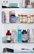 Medicine cabinet with bottles and other containers
